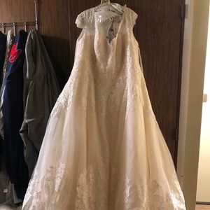 Wedding dress never worn still has tags